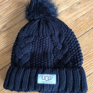 Black cable stitch hat with black Pom Pom